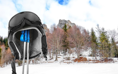 Ski helmet, poles and goggles for active winter vacation in mountains