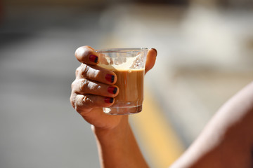 Woman is drinking a hot coffee