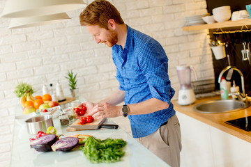 Redhair young man cooking food