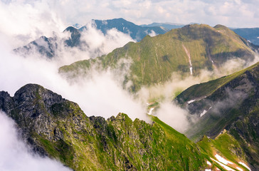 rising clouds over the Fagaras mountains of Romania. gorgeous nature scenery on high latitude in summertime