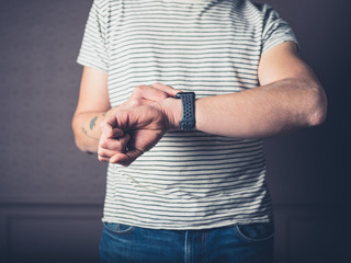 Young man with smart watch at home