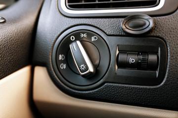 Fotoväggar - Lights control dial in a car