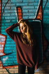 Woman at graffiti wall