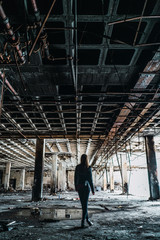 Woman standing in weathered room