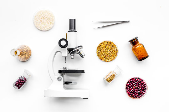 Food safety. Wheat, rice and red beans near microscope on white background top view