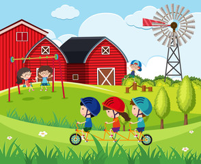 Children playing swing and riding bicycle on the farm