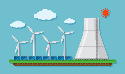 Field with wind turbines and silo