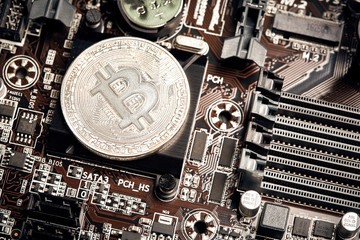 Bitcoin. New virtual money. Bitcoins lie on the video card, concept of mining.