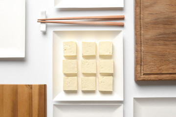 Tofu diced and served in a square plate, concept table setting