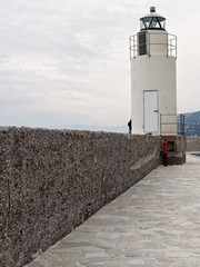 View of the lighthouse of city of Camogli, Genoa Province, Ligur