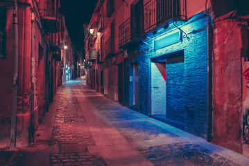 Car on dark street at night Fototapete