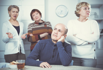 Portrait of conflict mature friends who are displeased