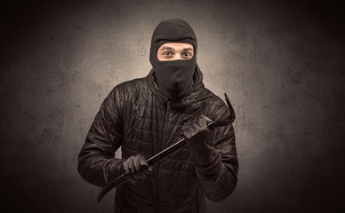Burglar with tool.