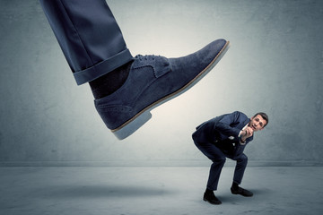 Employee getting trampled by big shoe
