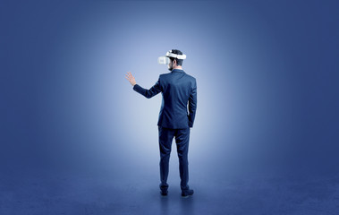Businessman in an empty room with vr glasses