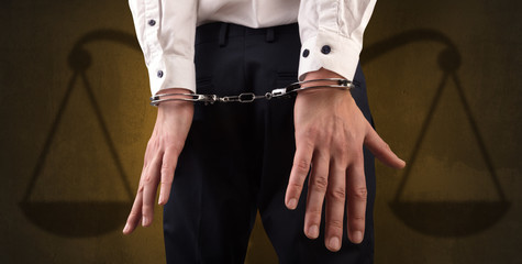 Arrested man with balance on the background