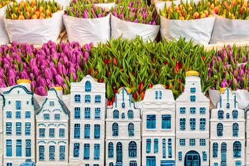Tulips in a flower shop with souvenir Amsterdam canal houses in front