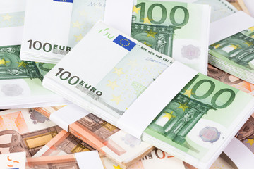 Closeup pile of fifty and one hundred euro banknotes