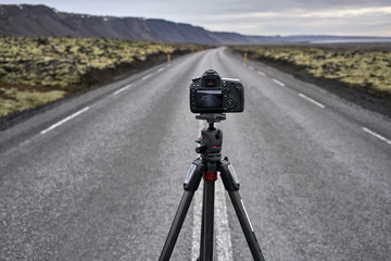 Tripod with camera on county roadway