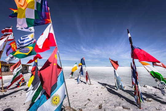 Uyuni Salt Flats - July 20, 2017: Flags landmark at the Uyuni Salt Flats, Bolivia