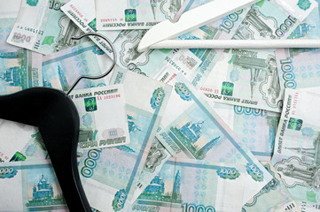 Russian rubles and empty clothes hangers in the wardrobe