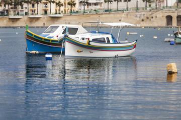 Beautiful colored small fishing boats in Marsaskala, Malta,
