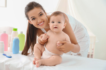 Mother and cute baby after bathing at home