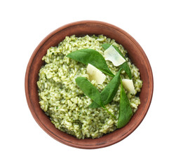 Dish with delicious spinach risotto on white background