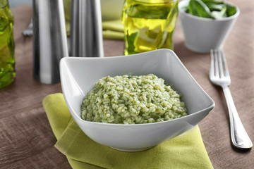Dish with tasty risotto on table, closeup