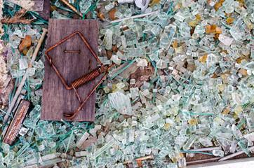 Broken mousetrap, broken glass