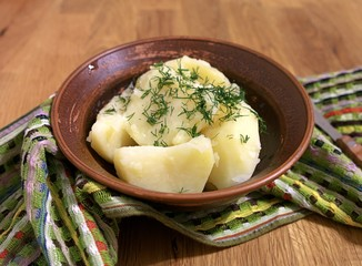 Boiled potatoes with butter and dill