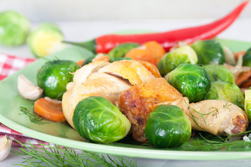 Homemade meal with cooked Brussel Sprouts and chicken drumstick