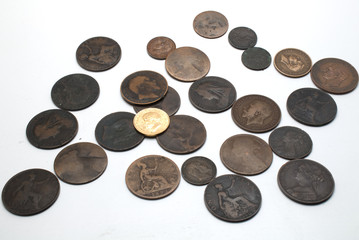 Old pennies with gold sovereign