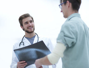 orthopedic surgeon examining an x-ray of the patient