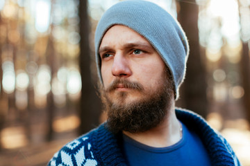 portrait of a bearded hipster tourist man in the woods forest
