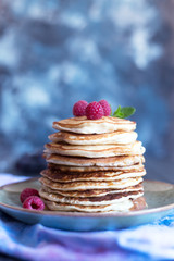 Pancakes with berries and honey. Copy space