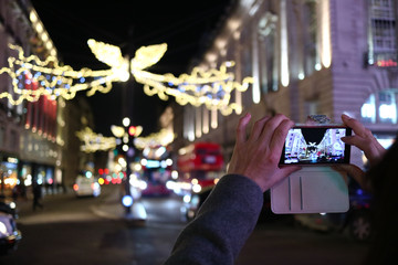 Taking a photo of the Christmas lights in London