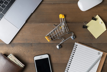 Shopping Cart with laptop and blank paper