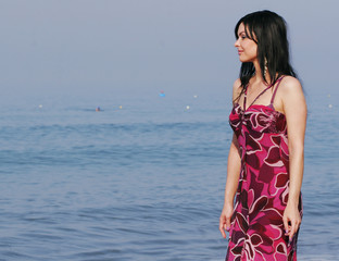 young woman on the sea in summer