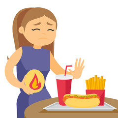 Caucasian white woman standing near table with fast food and having stomach ache from heartburn. Girl suffering from heartburn after fast food. Vector cartoon illustration isolated on white background