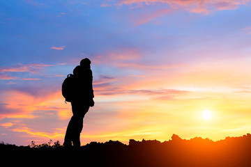 silhouette of man standing on the mountain,conceptual scene