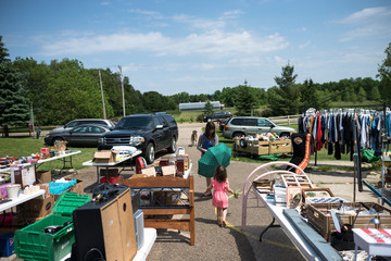 Mother and Daughter Shop at Garage Sale