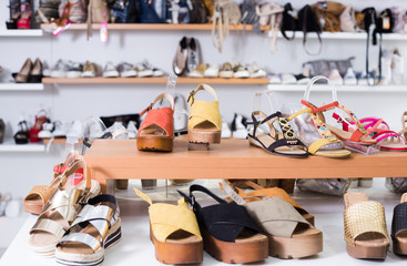 Image of showcase with summer shoes in the store.