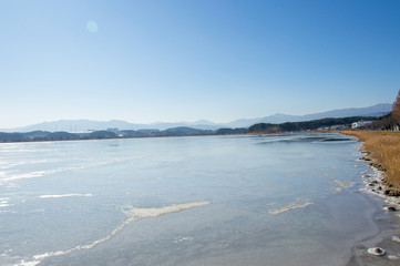 Idyllic frozen lake of Gyeongpo, Gangneung, Pyeongchang in South Korea