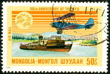 Ukraine - circa 2018: A postage stamp printed in Mongolia shows Airplane, Steamship. Series: U.P.U. Universal Postal Union, Centenary. Circa 1974.