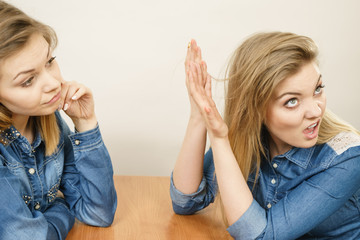 Woman talking with confident ignorant friend