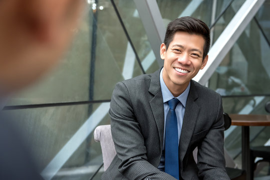 Asian businessman sitting at office lounge