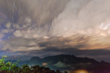 Startrail with Mountain view with foggy environment