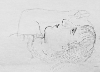 Pencil drawing on paper. Portrait of a lying man. Young man in depression