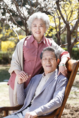 The elderly couple are outdoors